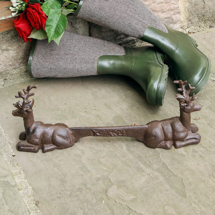 Cast iron boot scraper with a seated stag deer at each end. Designed to be outside all year round this scraper will add a stylish country feel to an entrance as well as keeping your hallway mud free Making a lovely 6th Wedding anniversary gift idea.