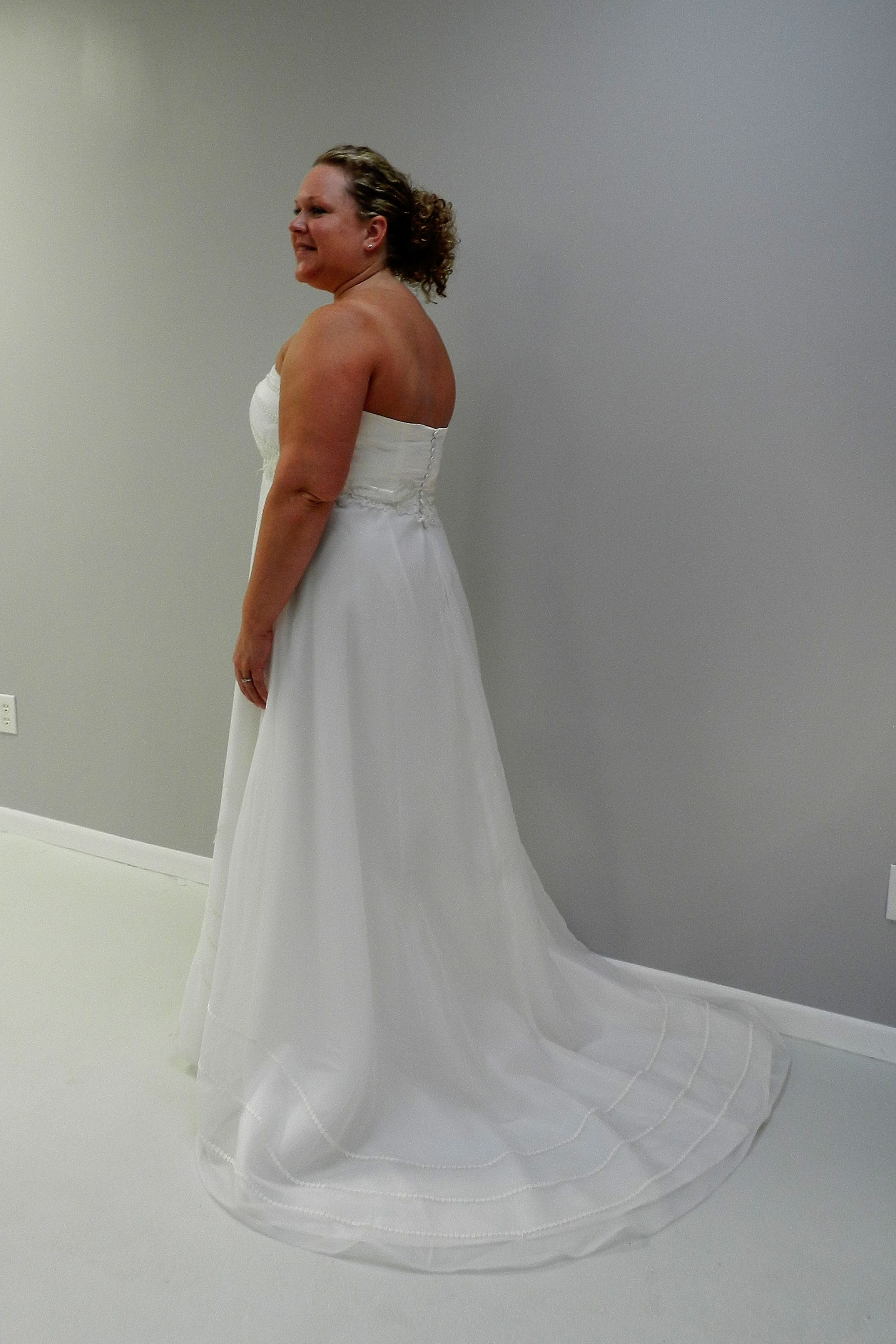 Custom made wedding dress  Custom made wedding dress made from the fabric of her motherus
