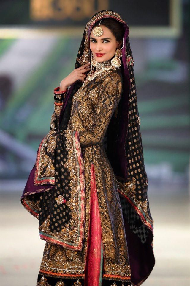 c42a14c694a bridal couture week. Pakistani fashion. Gold and black wedding dress.  Traditional lengha. Modern color combination. Pink and purple.