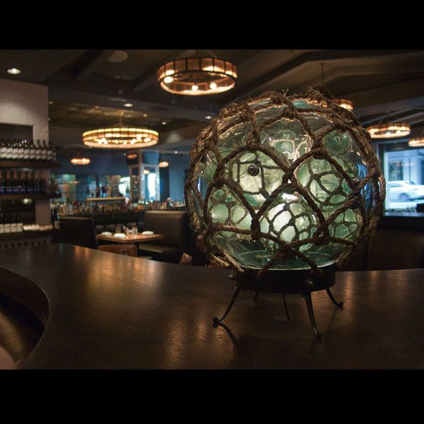 One of the four custom nautical orbs lights built for the renovation of los angeles restaurant