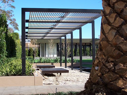 Sun control fencing and privacy screening by superior for Metal frame pergola designs