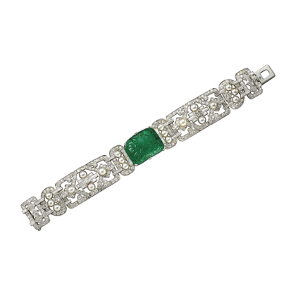 Antique pieces bracelet Platinum, one carved emerald (approx. 15.00 carats), natural pearls, diamonds. <br />Cartier New York, 1930.