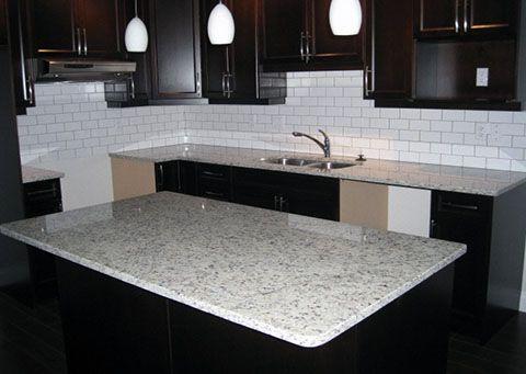 Moon White Granite Countertops With Dark Wood Kitchen
