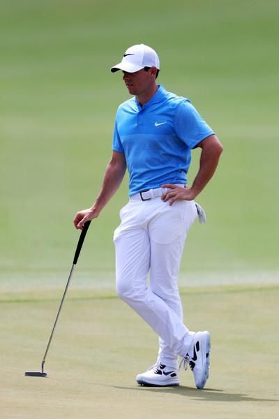 7d5c8bdd0 Rory McIlroy wearing Nike MM Fly Dri-Fit Stretch Golf Polo in Blue, Nike  Flat Front Dri-Fit Tech Golf Pants in White, Nike Air Zoom 90 It, Nike  Legacy 91 ...