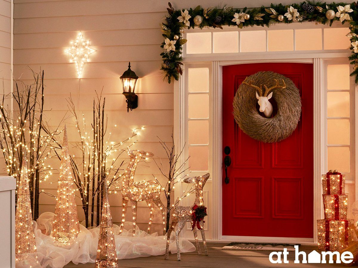 mix glitzy and glamorous pieces with gold and champagne decorations for a sophisticated seasonal outdoor space - Sophisticated Outdoor Christmas Decorations
