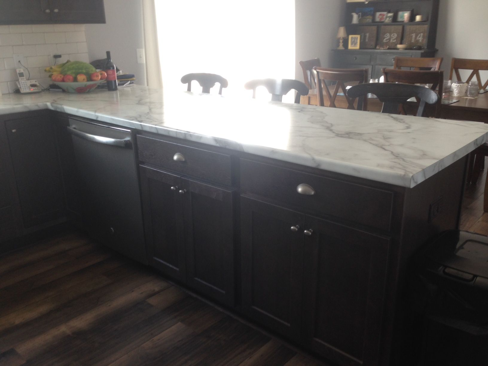 Hickory Buckboard cabinets with Calcutta marble laminate tops ...