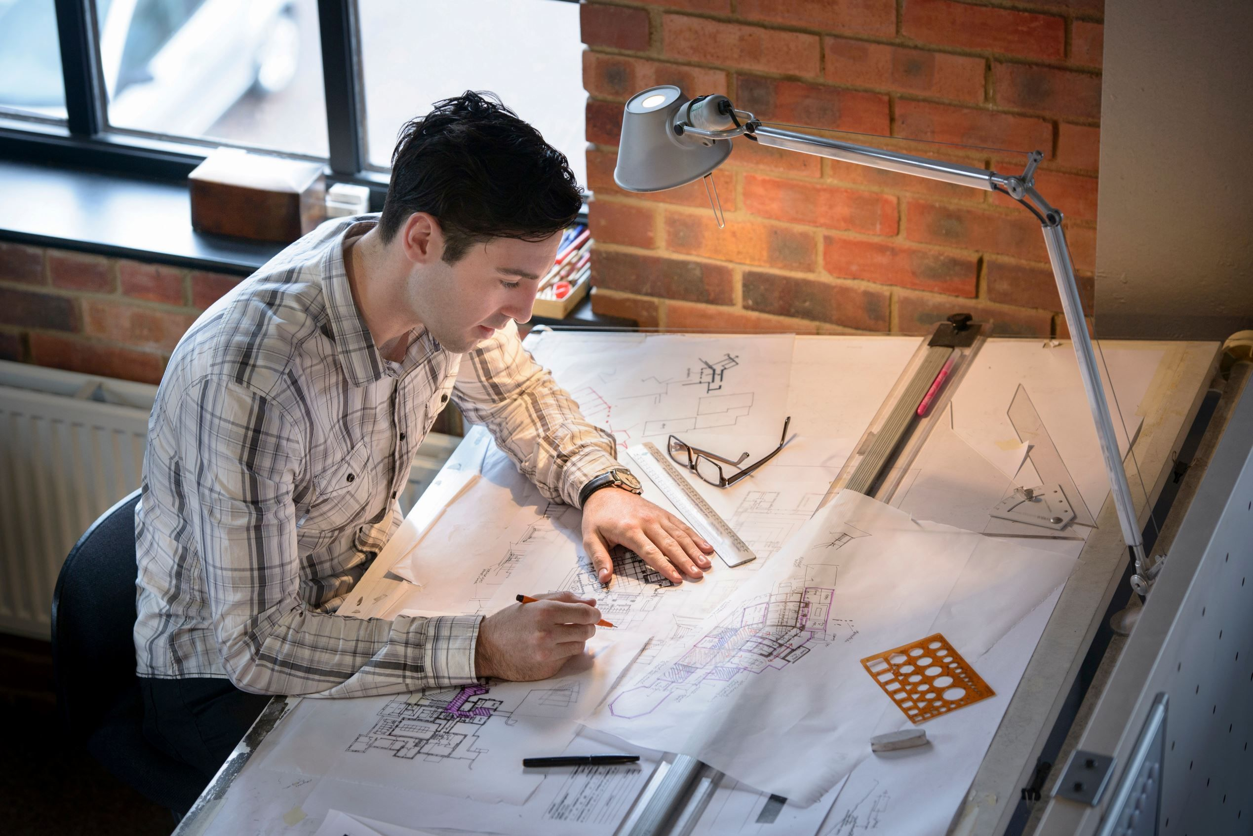 Architect drawing plans at drawing board - Monty Rakusen/cultura/Corbis