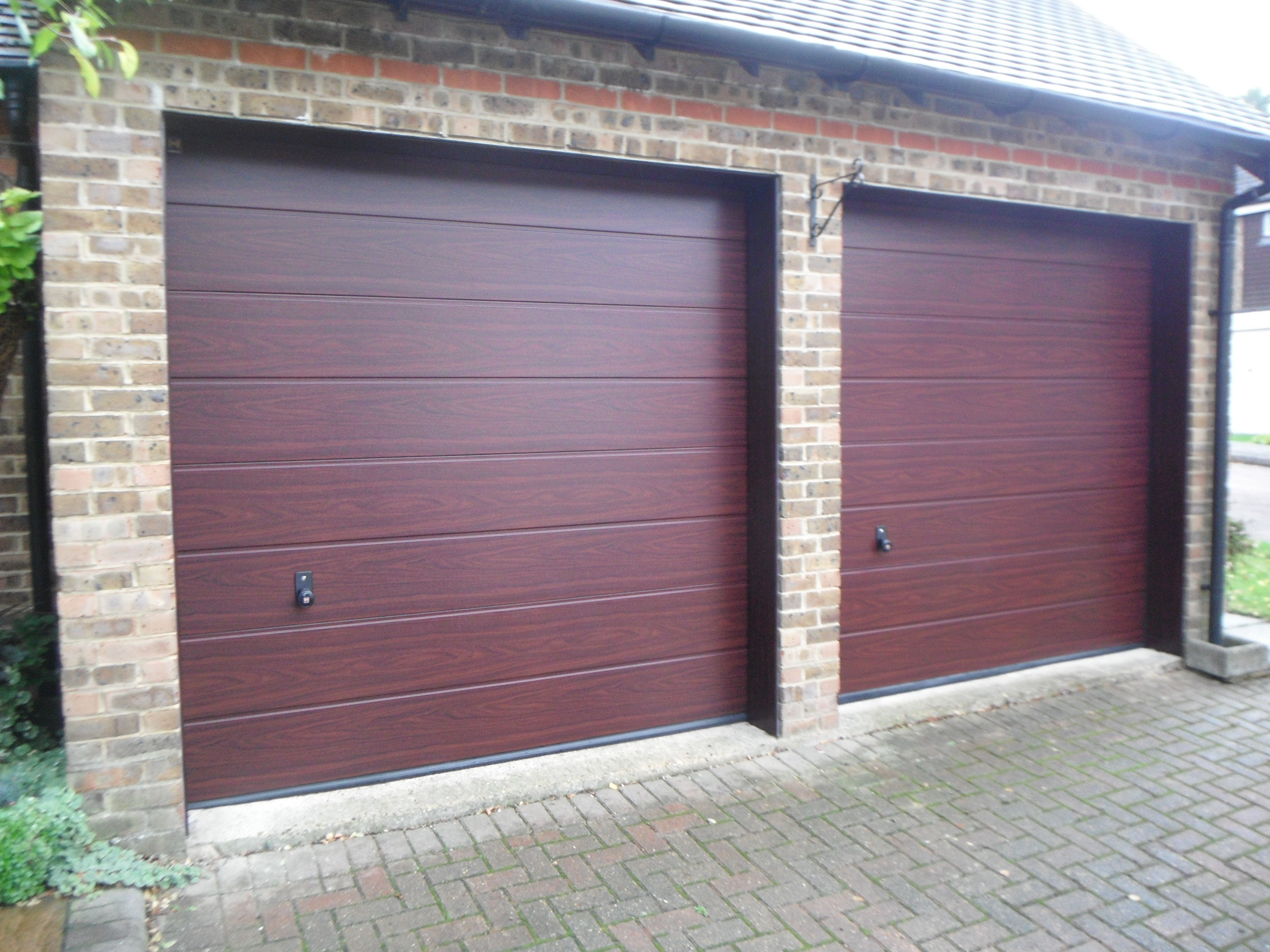 Doors and sidelights matching window on front and black onduline roof - Hormann M Ribbed Decograin Rosewood Sectional Garage Door With Black Handles
