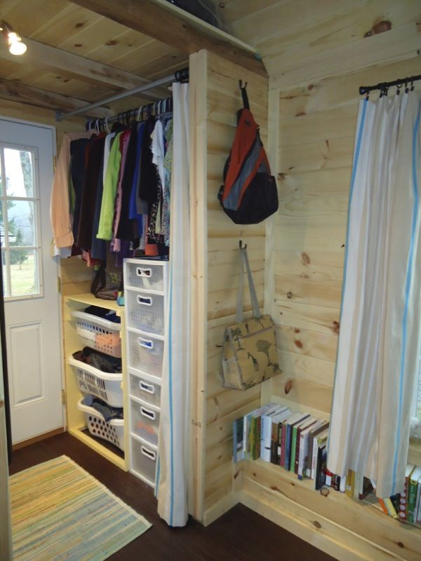 tiny house closet. brevard tiny house company near asheville nc 006 company: and their first home build. note closet storage next to front door, y