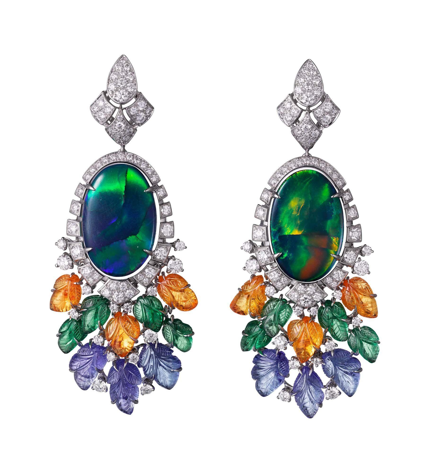 Étourdissant Cartier earrings in white gold, black opals, mandarin garnets, tsavorite garnets, tanzanites, and diamonds.