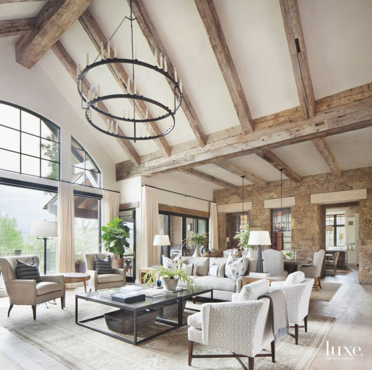 Iron Chandelier High Ceiling Room With Arched Windows With Wooden Beams And Stone Contemporary Rustic Living Room Rustic Living Room Design