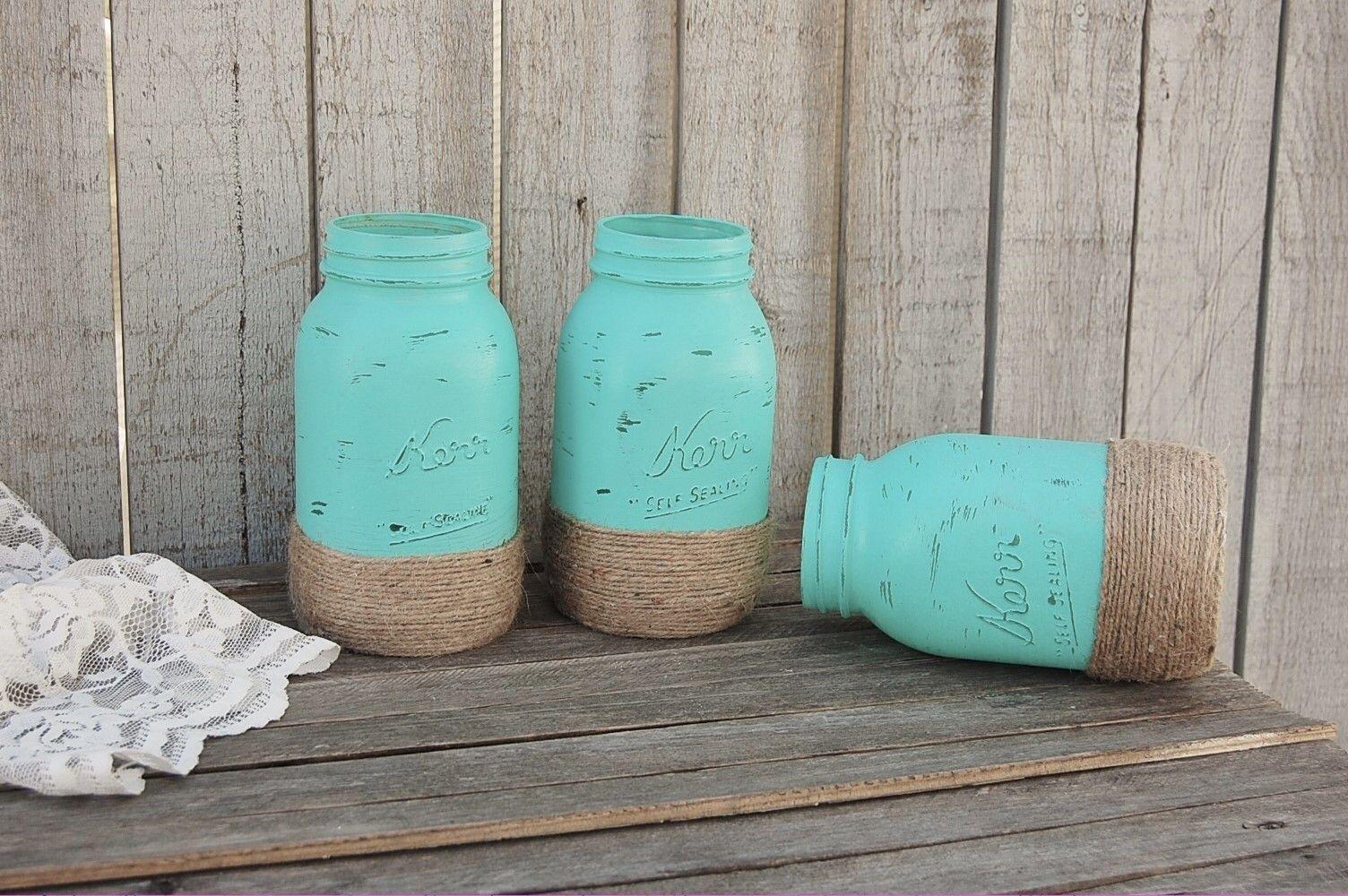 Photo of Aqua mason jars wrapped with jute