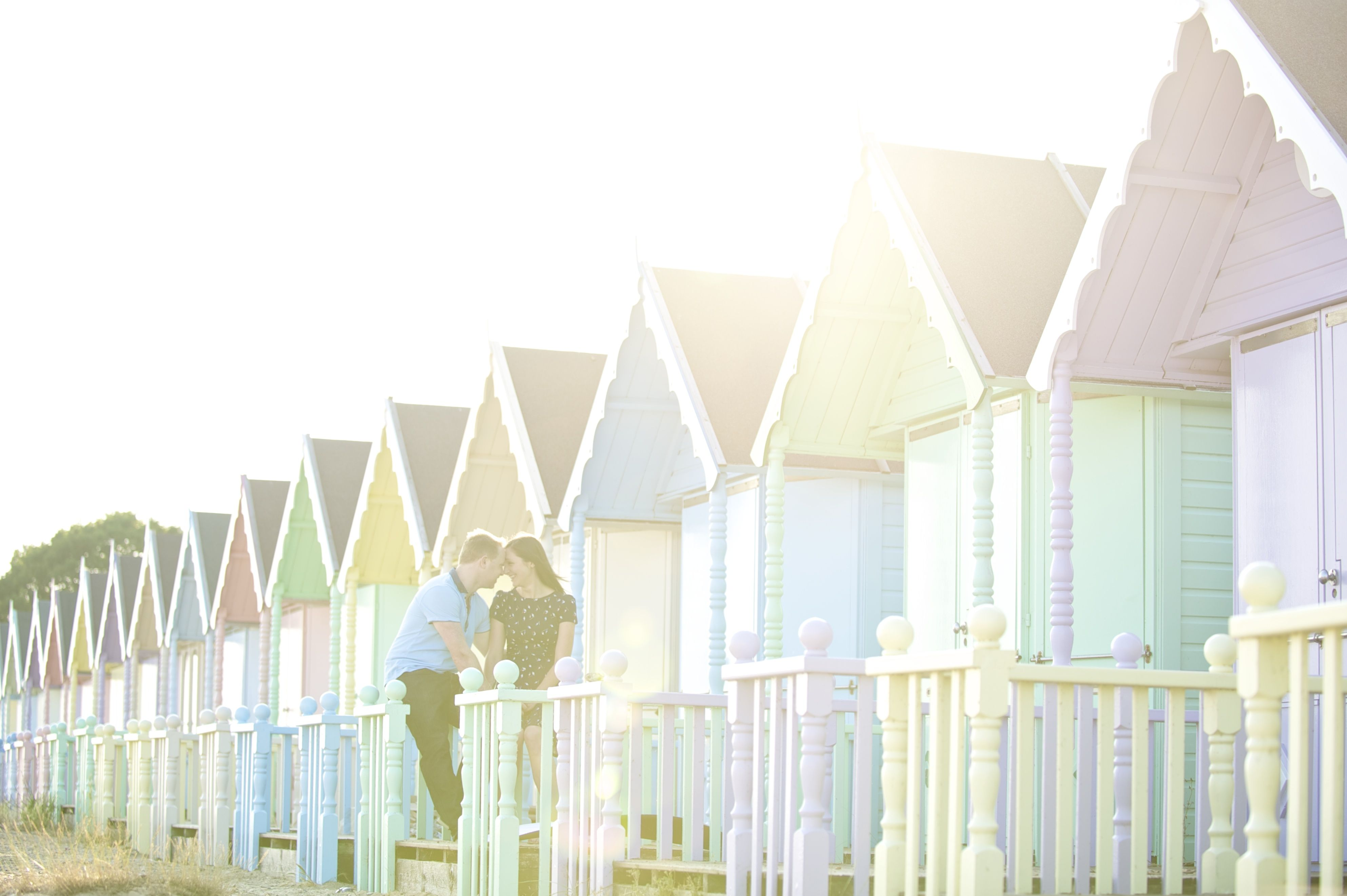 West Mersea pastel coloured beach huts, Pre-Wedding shoot. Great location for an engagement photography session.