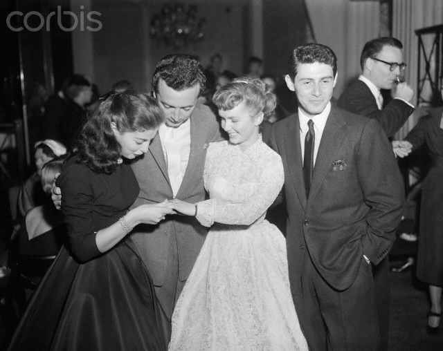 Debbie Reynolds shows her engagement ring from Eddie Fisher to Pier Angeli and her fiancé, Vic Damone on October 24, 1954.