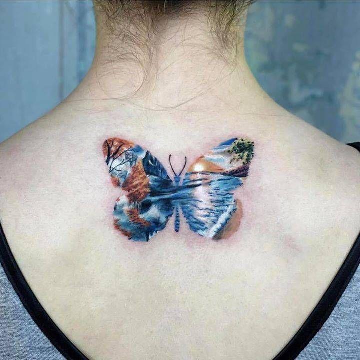5720578e2 Double exposure butterfly tattoo on the upper back. Tattoo Artist: Serkan  Demirboğa