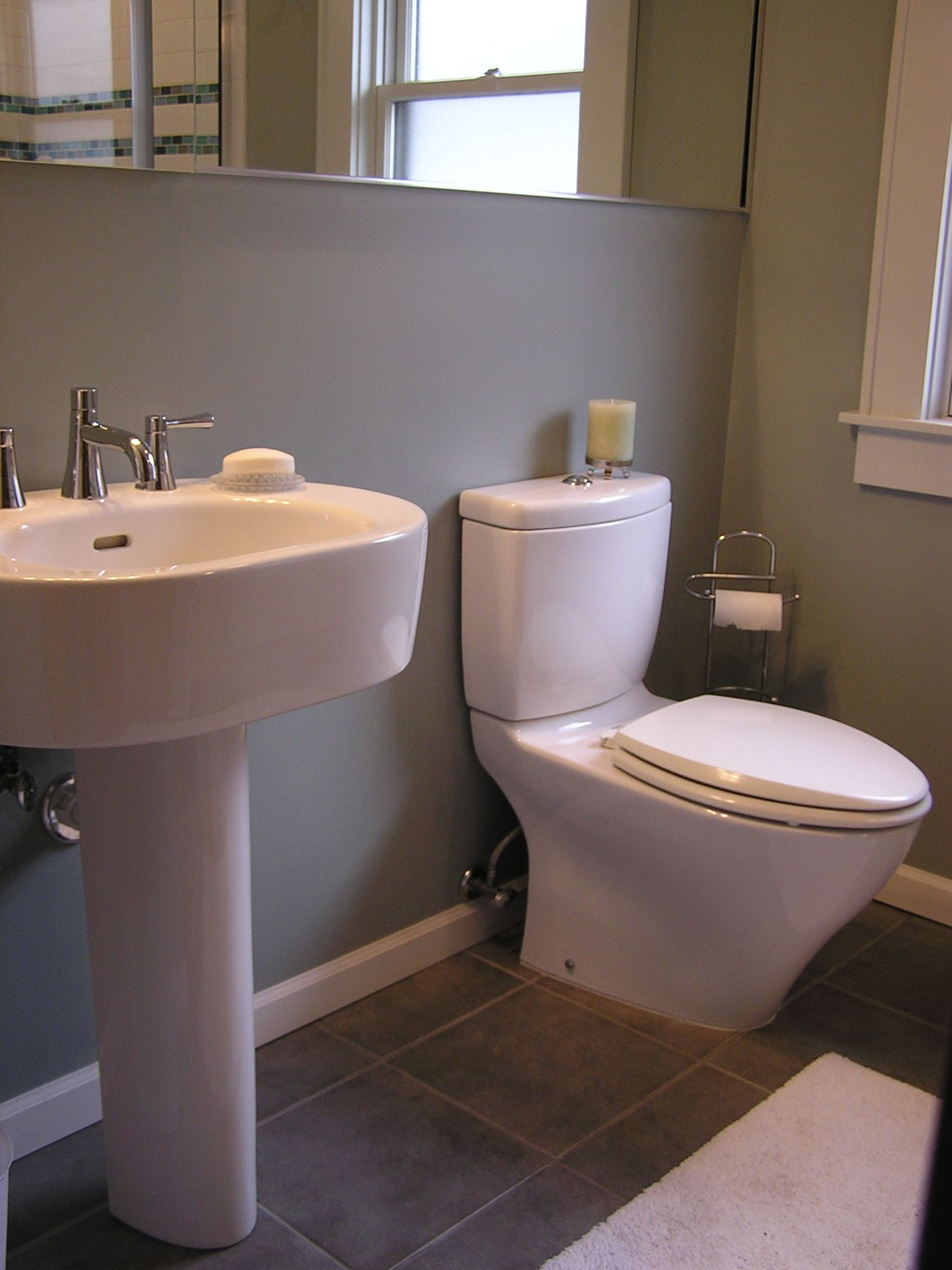 Updated a half bath with a pedestal sink & contemporary ...