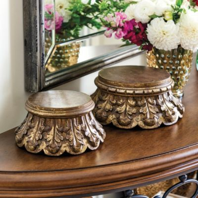 Add height and texture to tabletops and special objects with our classically inspired Wooden Pedestals. Each is hand carved of mango wood with acanthus details and finished in glowing aged gold.