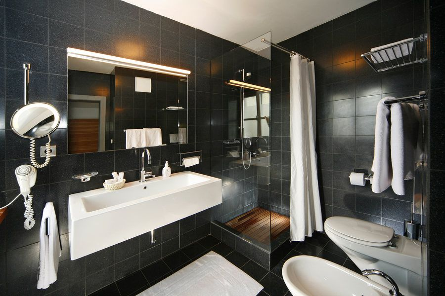 Black bathroom at Orso Grigio Black bathroom, Living