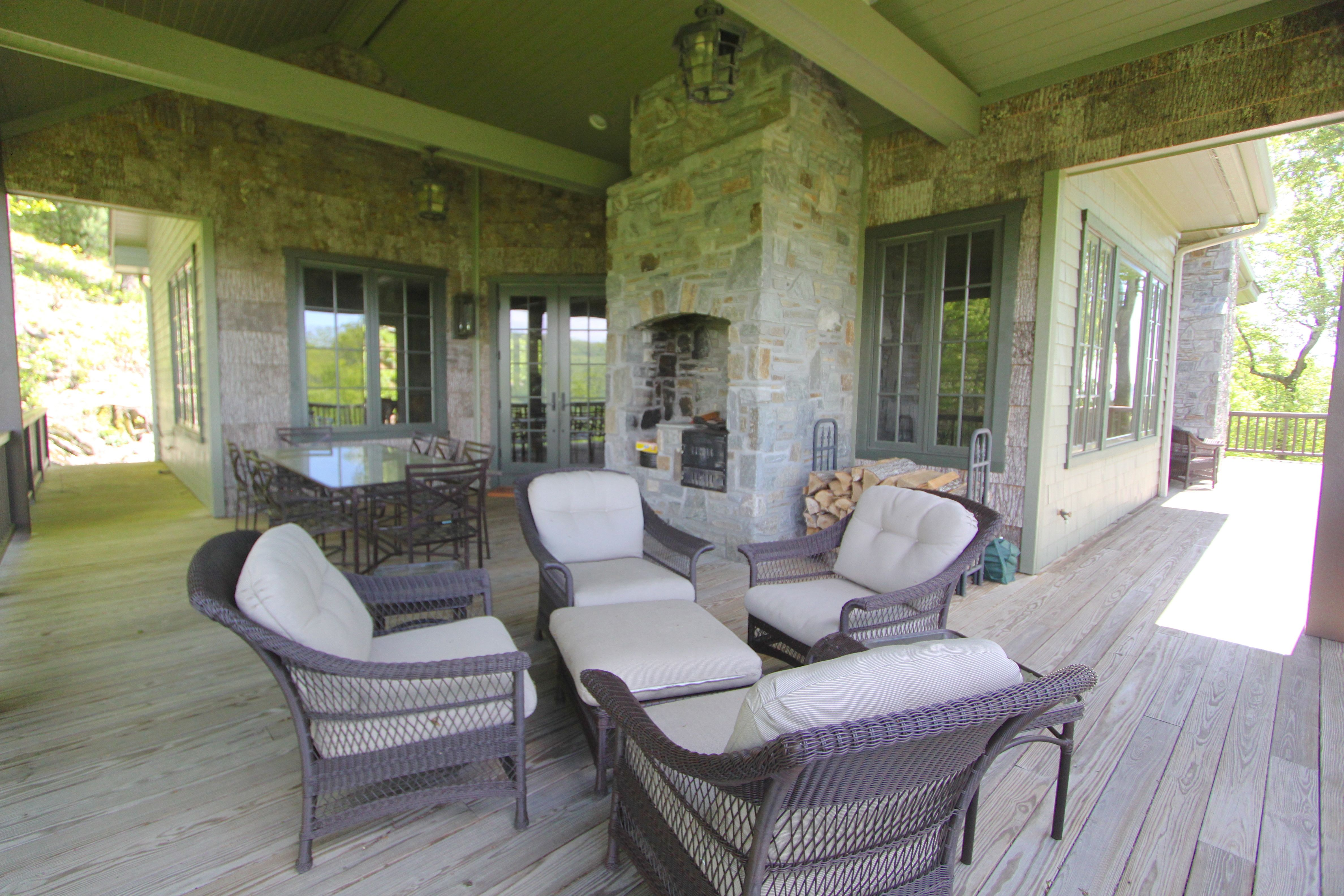 Integrated outdoor fireplace, perfect for cooking or relaxing in the cool mountain air of Blowing Rock!