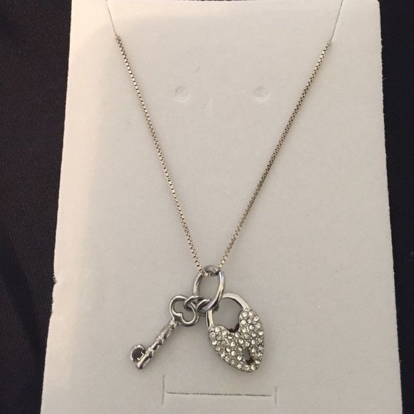 """Dainty lock and key pendant Mini lock and key on 18"""" sterling silver chain. Pendant measures 1"""". Spring clasp. Jewelry Necklaces"""