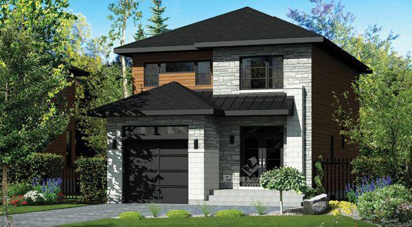 © Planimage - À regarder la façade de cette maison à étage, on ne dirait pas qu'il s'agit d'une si vaste demeure!