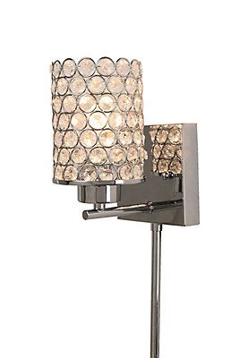 beaded glass encased by circular patterns in a chrome finish creates the modern appeal in our glam beaded wall sconce its distinct design rewards your