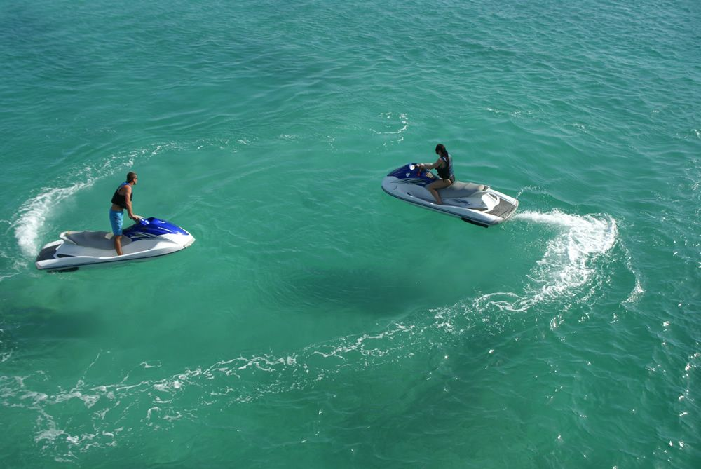 Ride an exciting waverunner while cruising the harbor