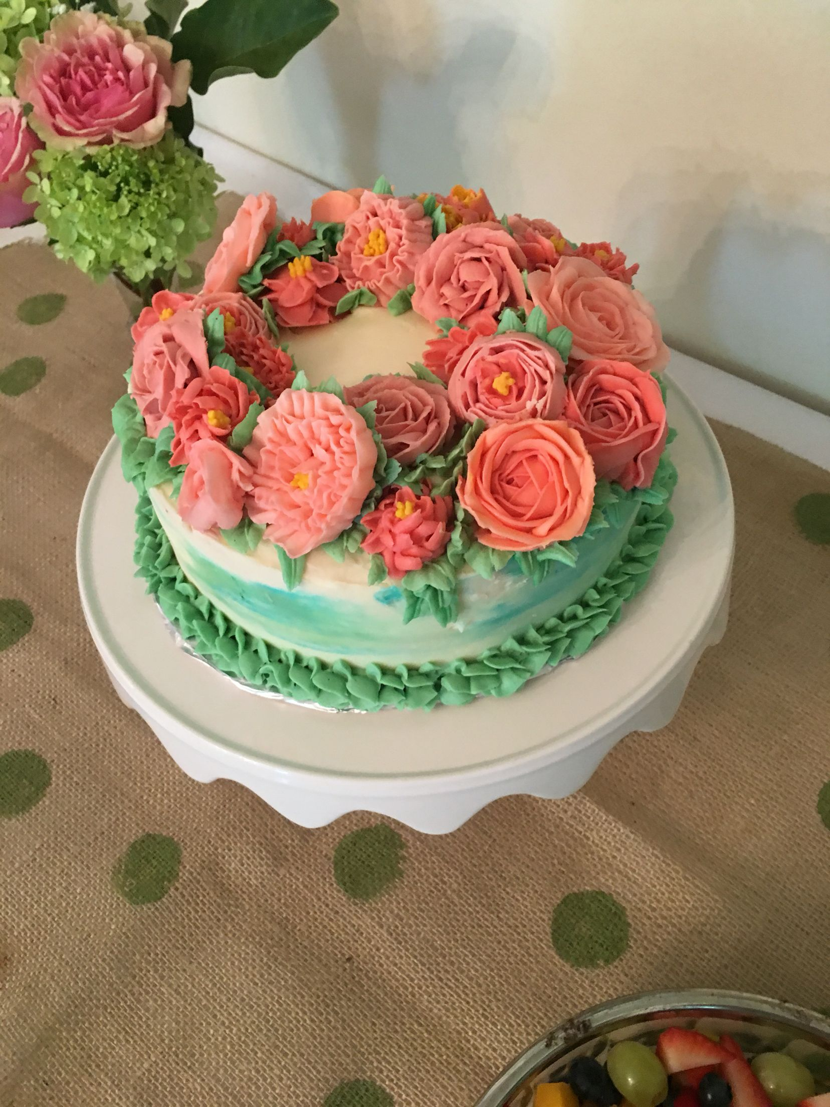 Buttercream flowers with watercolor buttercream sides. Baby shower cake.