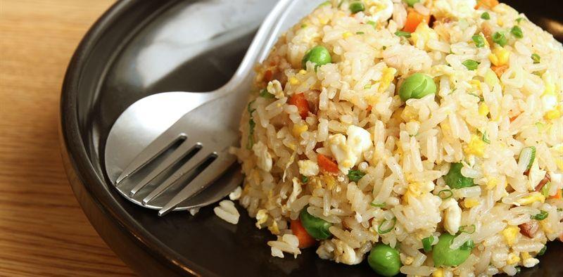 simple fried rice on black plate