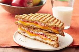 Turn left-over turkey into a café-style sandwich.  This turkey panini with Cheddar and tomatoes is grilled to perfection.