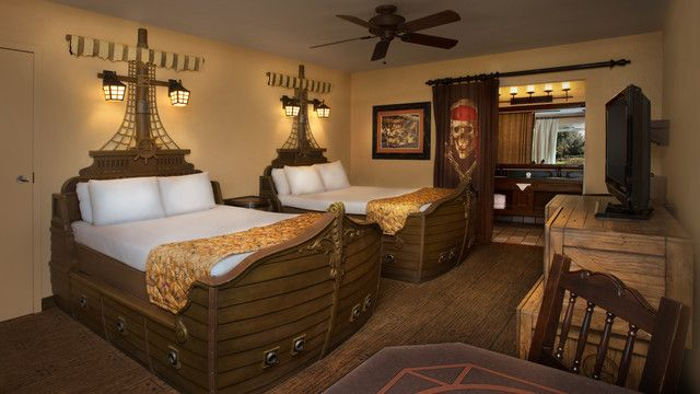Disney S Caribbean Beach Resort Moderate Offers Themed Pirate Rooms 2 Ship Beds Sconces End Table Chair Tv Framed Wall Art Fan