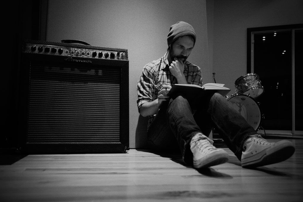 This photo is of an artist writing lyrics. The fact that he is by ...