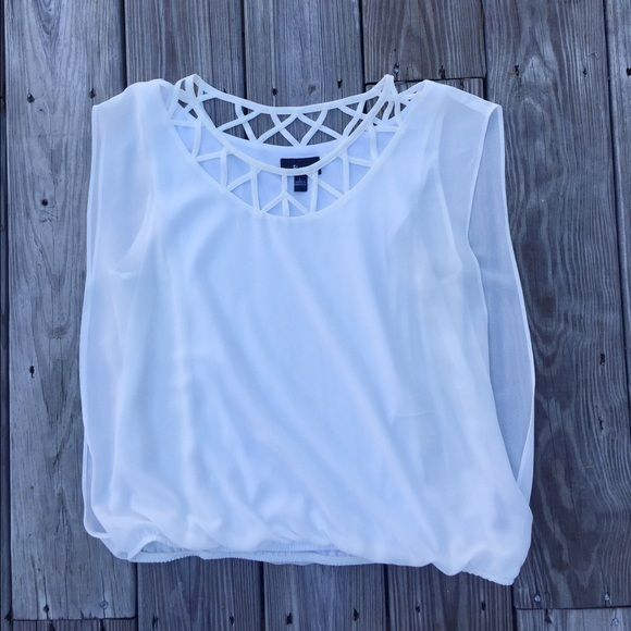 Adorable white top!! A beautiful top with a cute patterned neckline. Has a tank top lining underneath. The bottom of the shirt (as pictured) is elastic. There is a small smudge of makeup on the neckline (as pictured). Shell & lining are both 100% polyester Tops