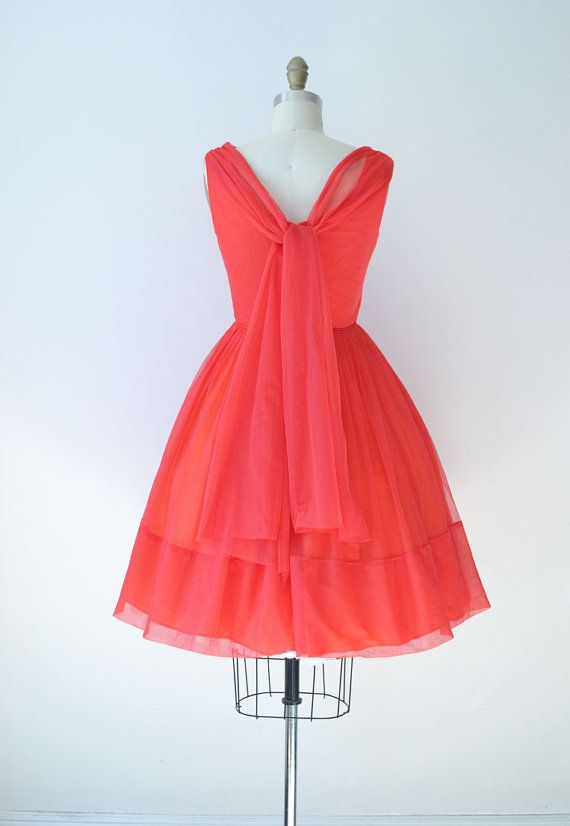 What is a womans dress with full skirt and fitted bodice?