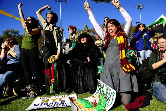 Fans cheer their college teams at the International Quidditch Association's 2011 World Cup.