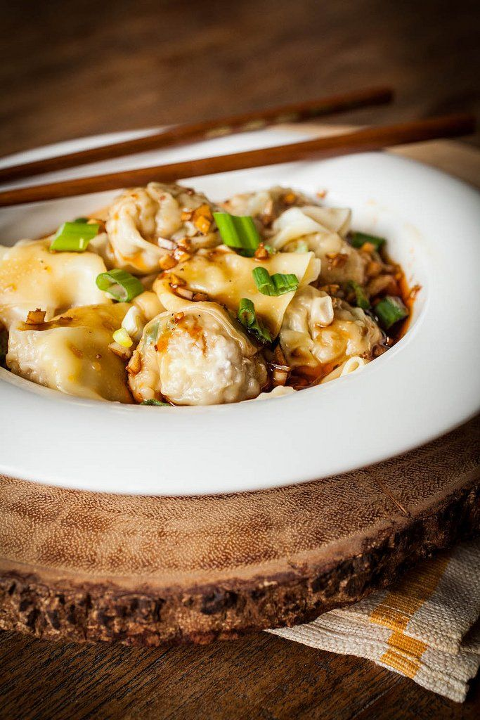 Easy to make pork and scallion filled wontons in a spicy Sichuan sauce with a video tutorial.