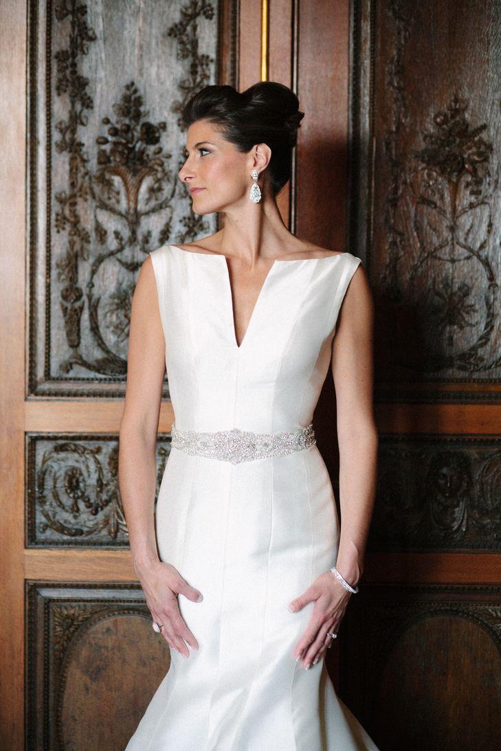 Sleek satin mermaid wedding gown with high neckline and deepv