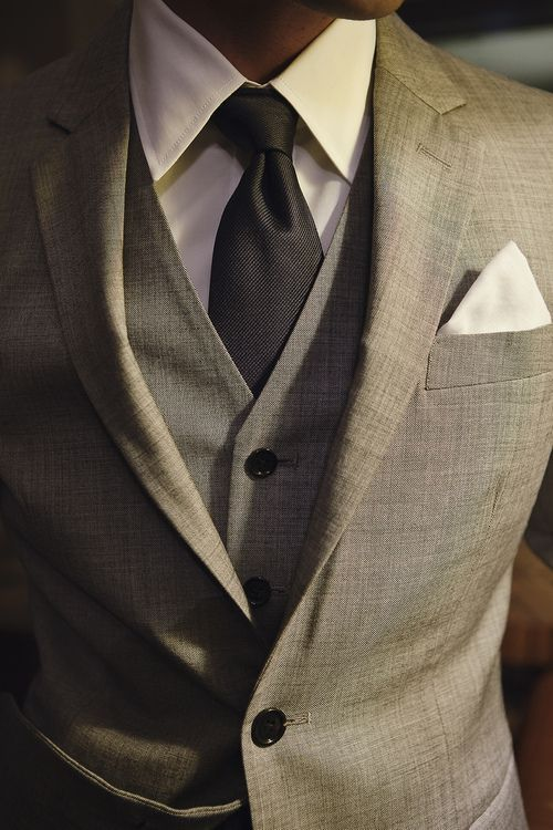 Grey suit with vest and pocket square.