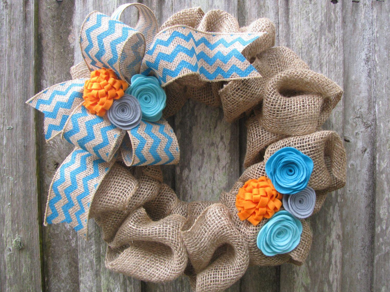 "Love the colors (Set of 2 - Spring Burlap Wreath 15"" - Turquoise & Orange Rosettes with Chevron Ribbon. $84.00, via Etsy.)"