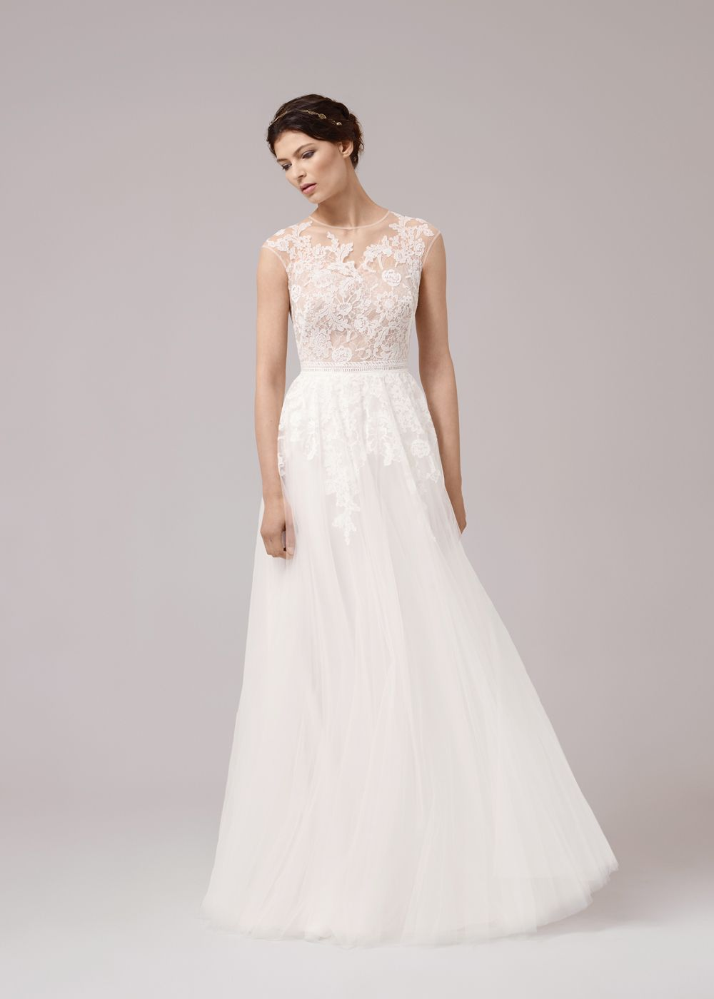 A beautiful aline wedding dress with french and italian lace