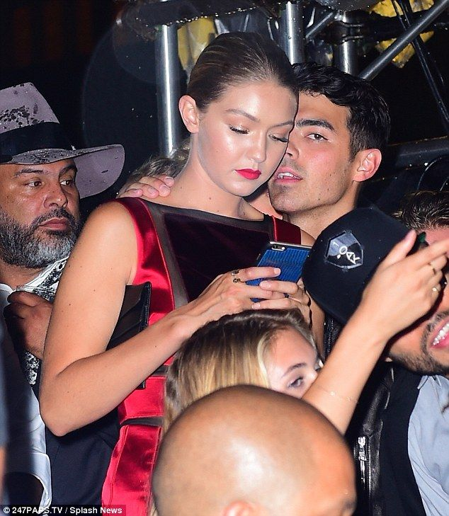 Young love: Gigi, 20, remained distracted by her phone as the former Disney star spoke in ...