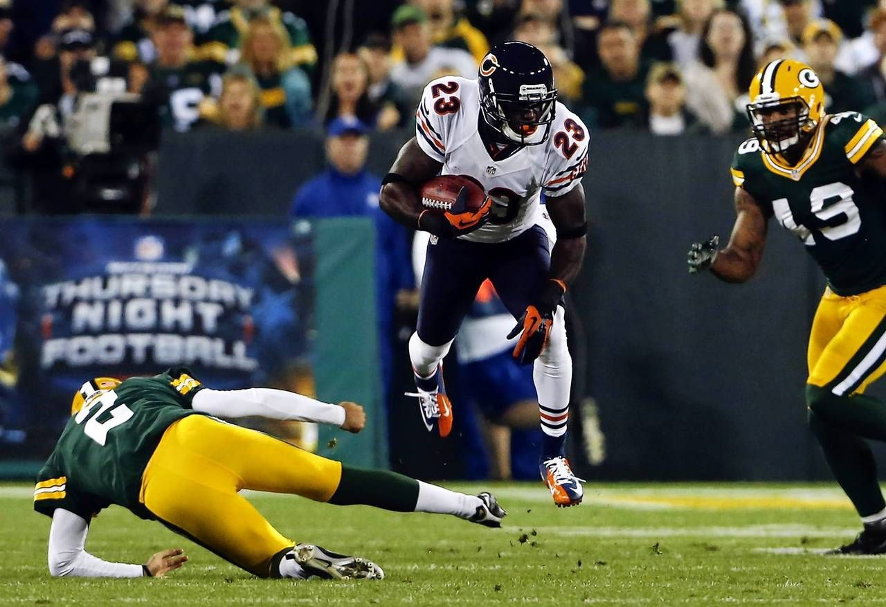 Devin Hester Is Tripped Up By Packers Kicker Mason Crosby On A Kick Return In The Second Quarter Bears Packers Chicago Bears Packers