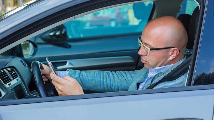 Do you text and drive? Your car insurance may go up — CNN