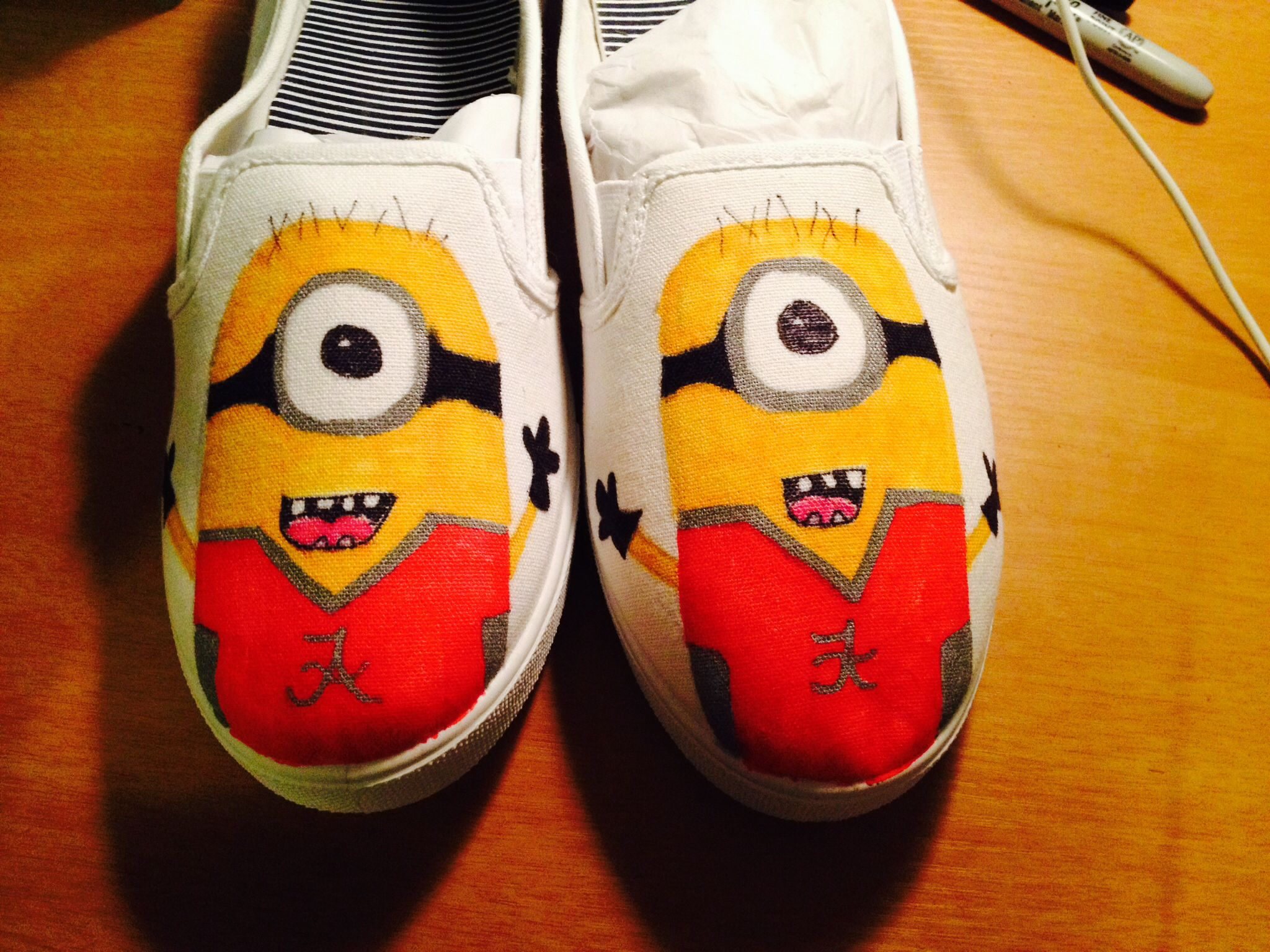 I made these Roll Tide Minions myself. Used magic markers and $6 shoes from Walmart :)