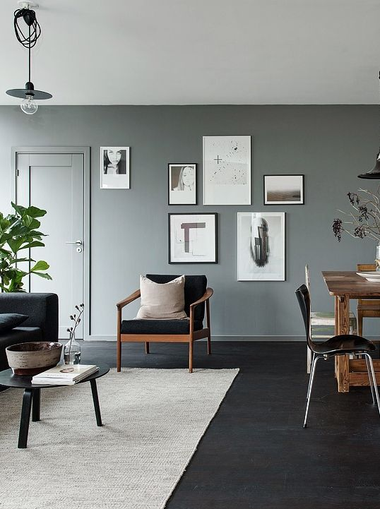 Black Floors Grey Walls And Lots Of Art Pieces Via Living Room