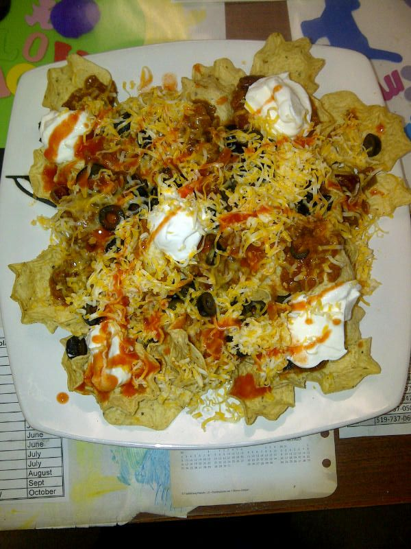 nacho's, chili, black olives, sour cream, cheese & franks red hot.... Teri & I lunch!