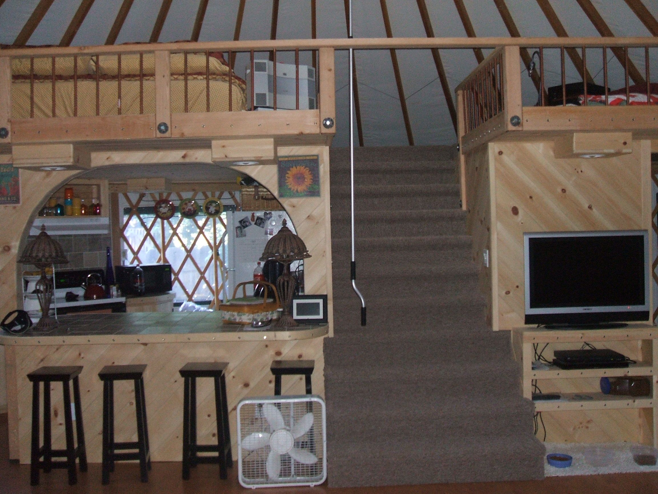 Yurt with a loft above kitchen how cool yurt straw for Yurt bathroom designs