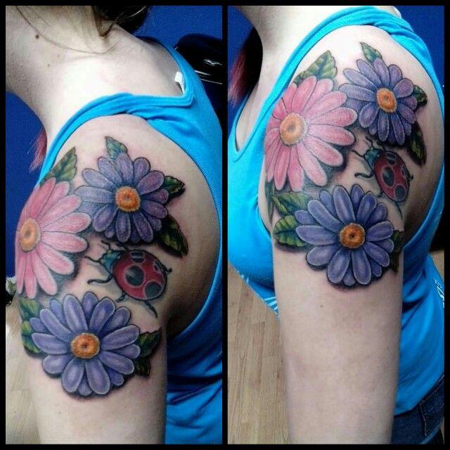 My daisy flowers and ladybug tattoo | Lady bug tattoo ...