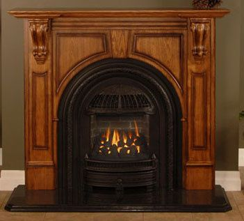 Selby wood mantel features an arched opening. Available in 2 ...