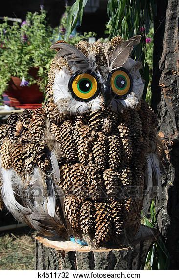 Souvenir owl made from pine cones Stock Image